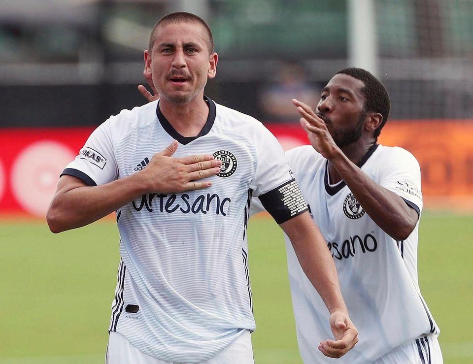 Philadelphia Union soccer player player Sergio Santos, left,