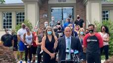 Gym owners surround attorney James Mermigis in Syosset