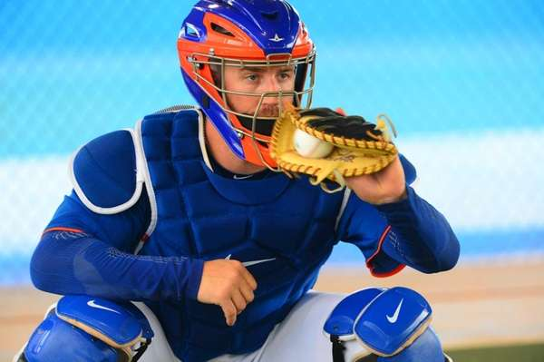 Catcher John Buck doing catching drills today during