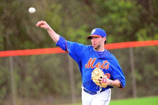 Mets pitcher Shaun Marcum plays catch during a