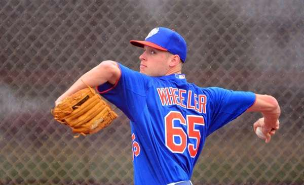 Mets pitcher Zack Wheeler delivers a pitch during