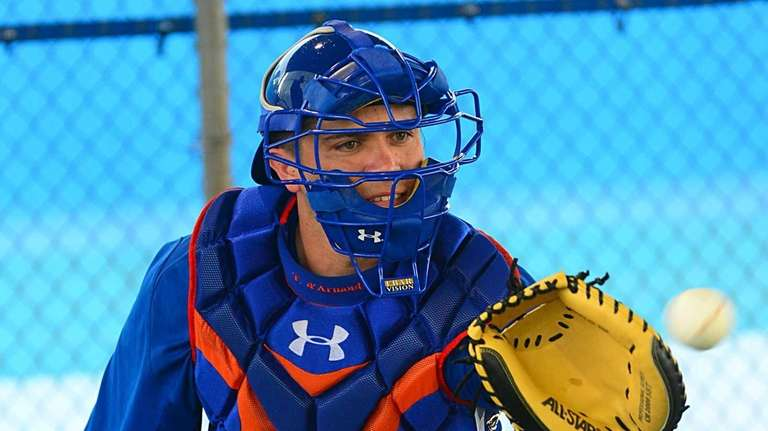 Catcher Travis D'Arnaud does catching drills during a
