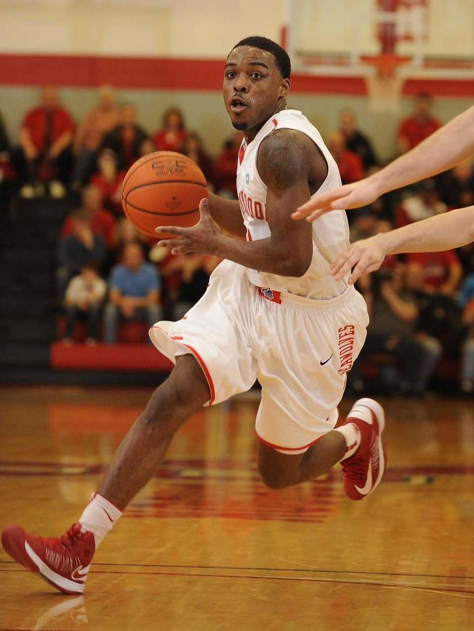 Stony Brook guard Anthony Jackson drives the ball