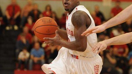 Stony Brook guard Anthony Jackson drives the ball