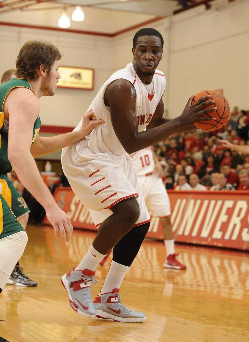 Stony Brook forward Jameel Warney looks to drive