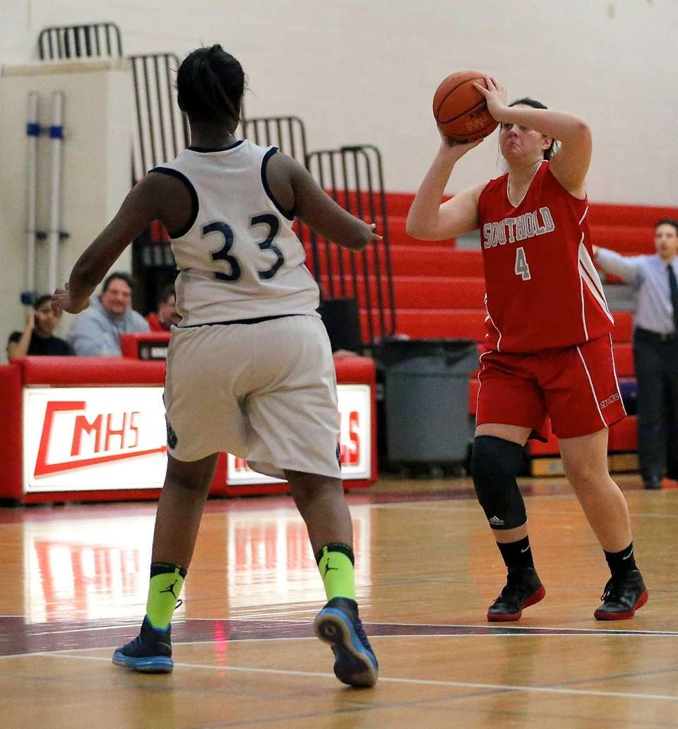 Southold's Melissa Rogers tries for a three-pointer against