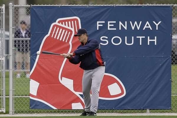 Boston Red Sox manager John Farrell hits a