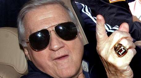 Yankees owner George Steinbrenner points as he answers
