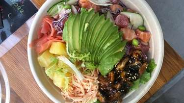 A poke bowl with salmon, tuna, roasted eel,