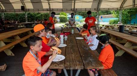 Campers enjoy lunch on the third day of