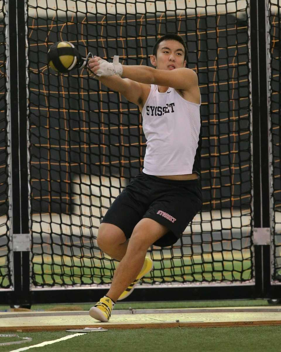Syosset's Eric Sheng competes in the weight throw