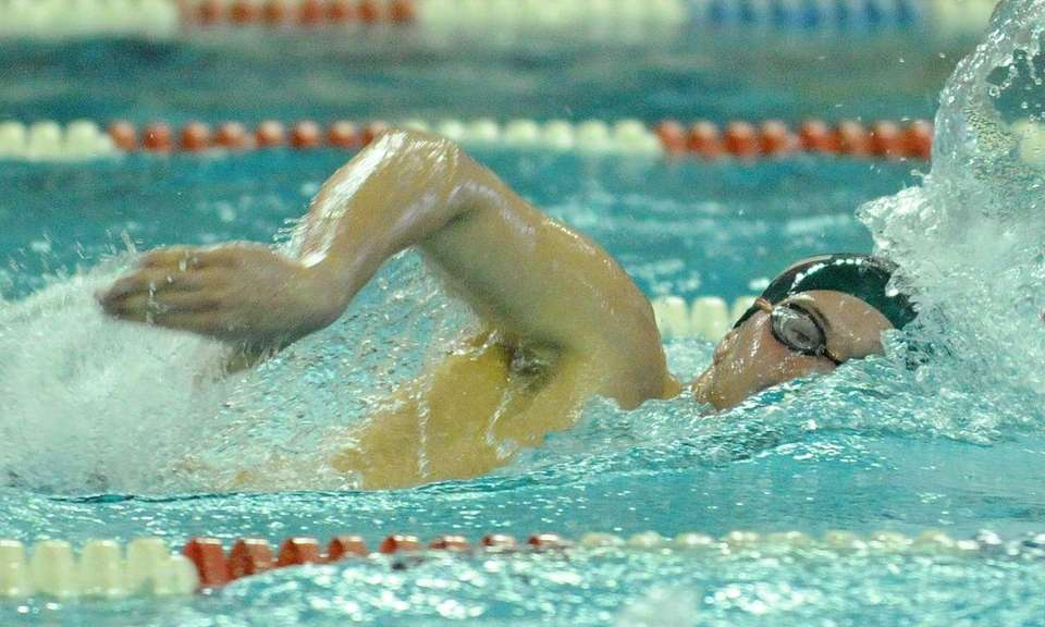 Kevin Konarski of Lindenhurst High School swims to