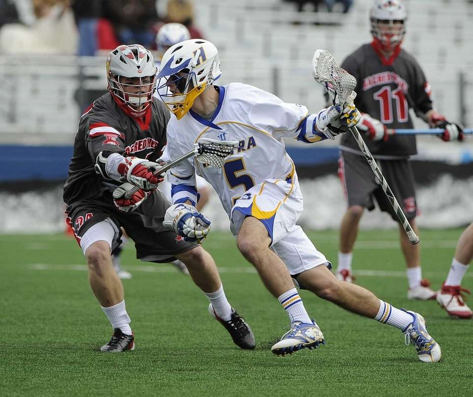 Hofstra attacker Sam Llinares is defended by Sacred