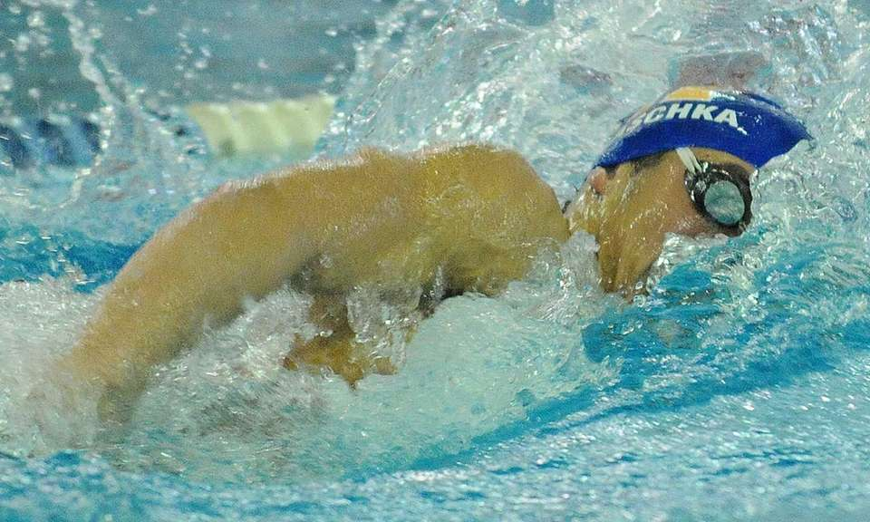 Justin Plaschka of Hauppauge High School swims to