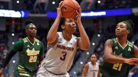 Connecticut's Megan Walker (3) looks to shoot as