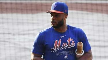 Mets second baseman Robinson Cano looks on during