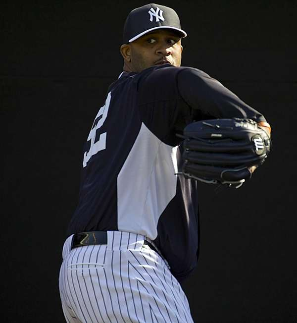 Yankees pitcher CC Sabathia pitches in the bullpen