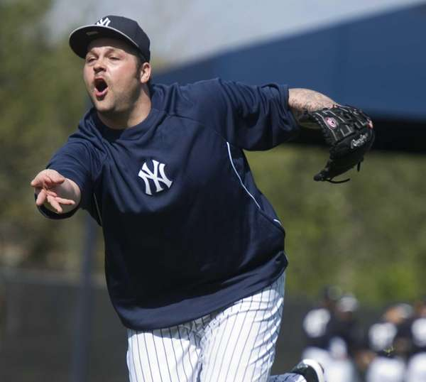 Yankees pitcher Joba Chamberlain taking part in fielding