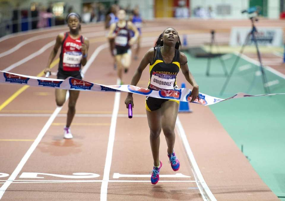 Ashley Suffriant crosses the finish line for Uniondale