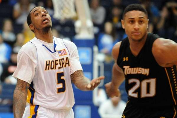 Hofstra's David Imes, left, tries to get a