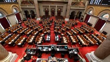 Members of the New York State Assembly meet