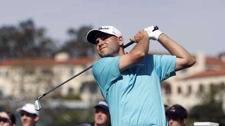 Bill Haas drives on the 14th tee in