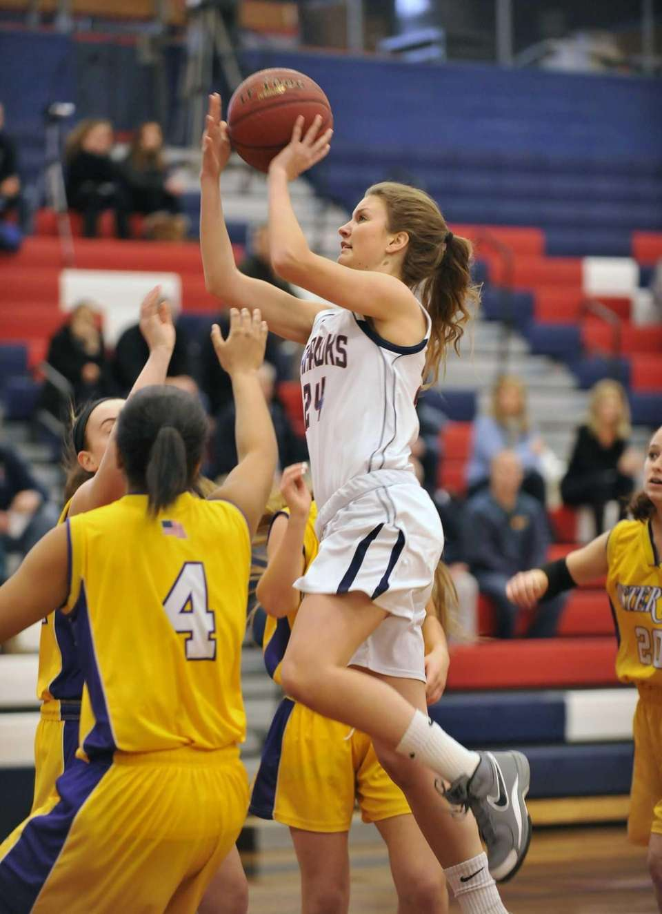 Katie Durand of Cold Spring Harbor shoots over