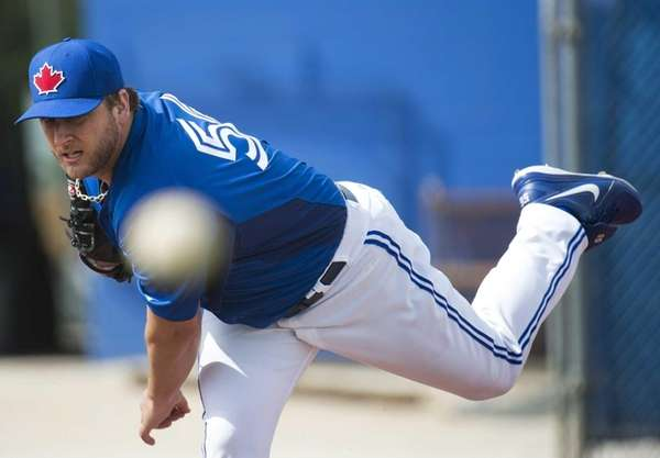 Toronto Blue Jays starting pitcher Mark Buehrle throws