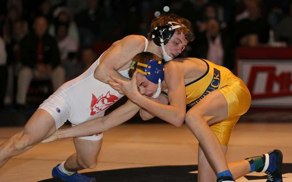 Center Moriches' Michael Menzer, left, looks to takedown