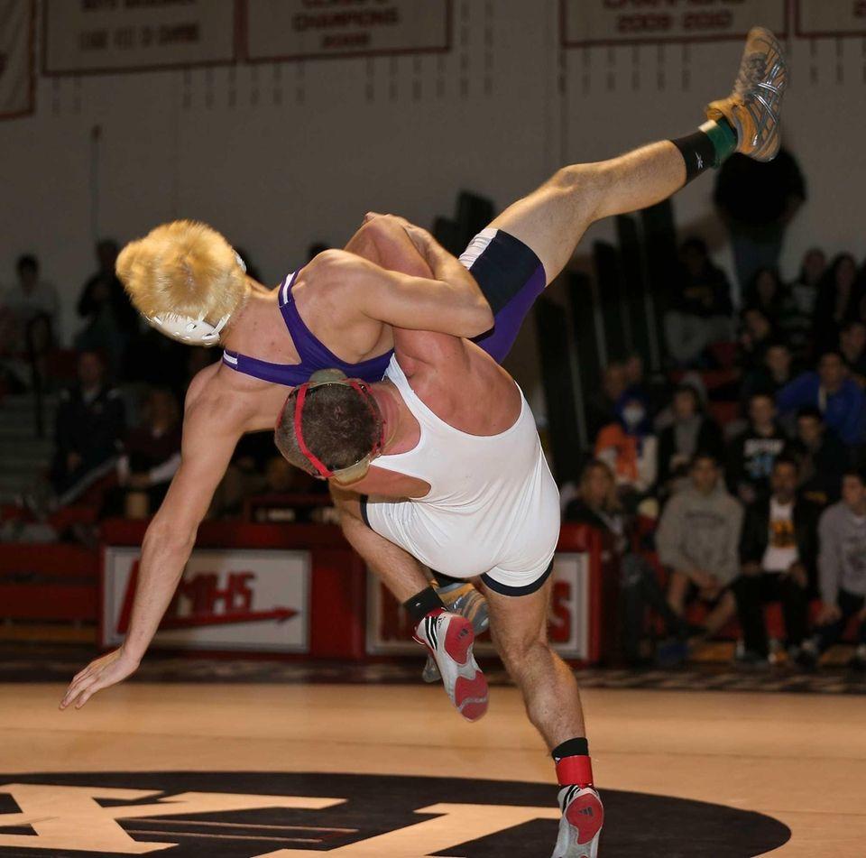 Center Moriches' Nick Tyson, white, gets the takedown