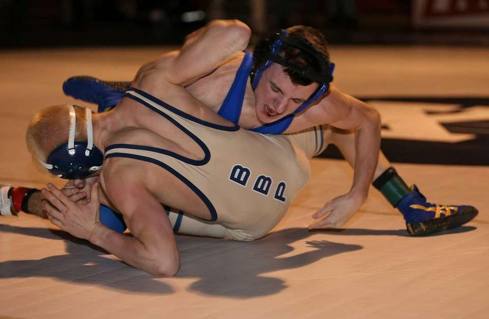 Smithtown Christian's Peter Schneider, top, looks to roll