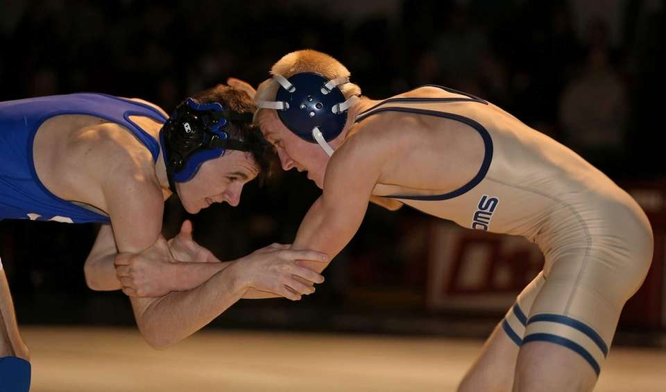 Smithtown Christian's Peter Schneider, left, grapples with Bayport-Blue