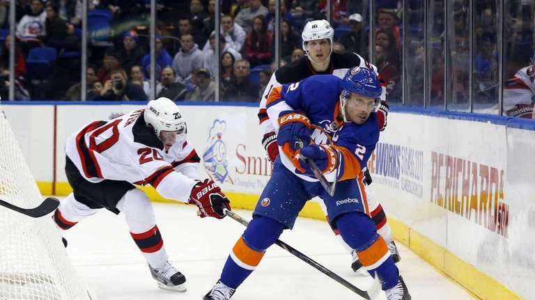 Mark Streit of the Islanders clears the puck