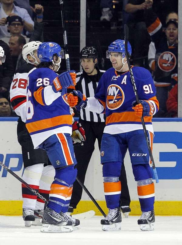Matt Moulson of the Islanders celebrates his second