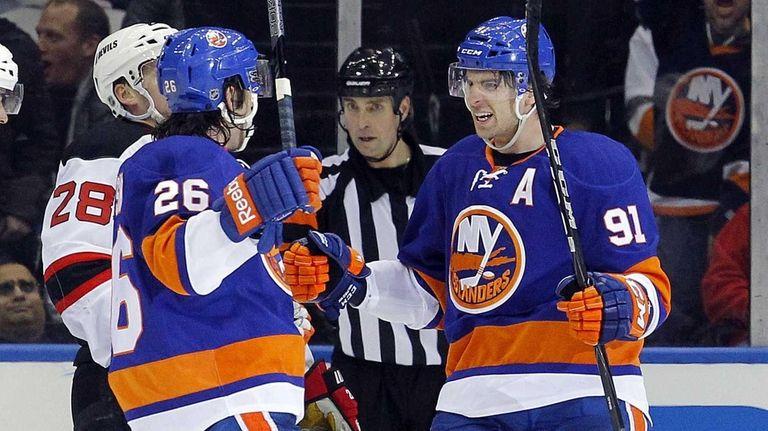 Matt Moulson of the Islanders celebrates his second