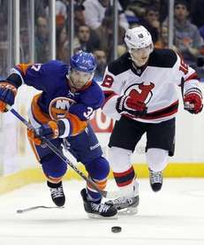 Brian Strait of the Islanders carries the puck