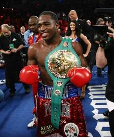 Adrien Broner celebrates after beating Gavin Rees of