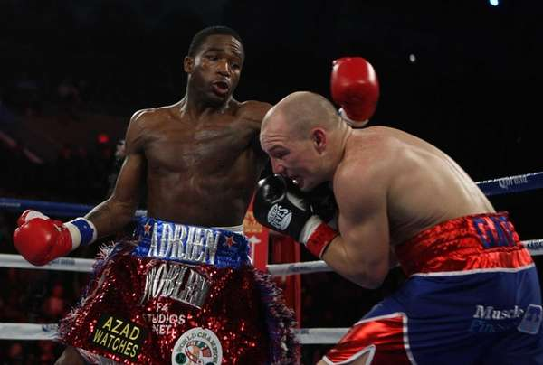 Adrien Broner, left, of throws a punch on