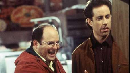 From left, George (Jason Alexander) consults with Jerry