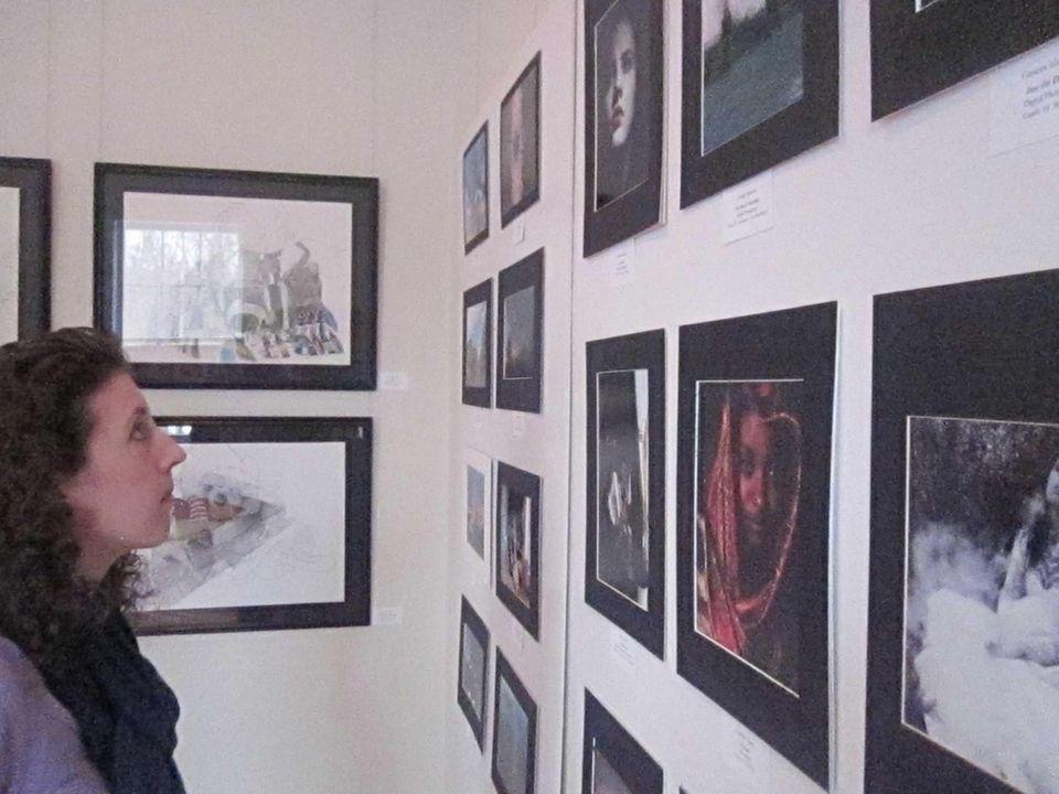 Stephanie DeSimone of St. James looks at artwork