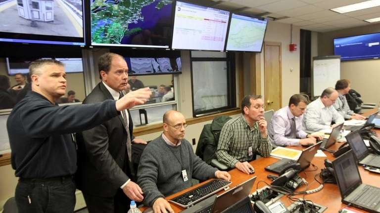 Long Island Rail Road personnel monitor security and