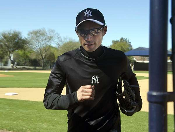 Ichiro Suzuki leaves the field after throwing long