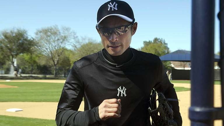 Ichiro Suzuki leaves the field after throwing long