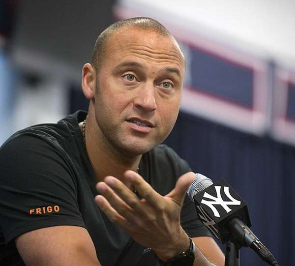 Jeter talks to the media after reporting to
