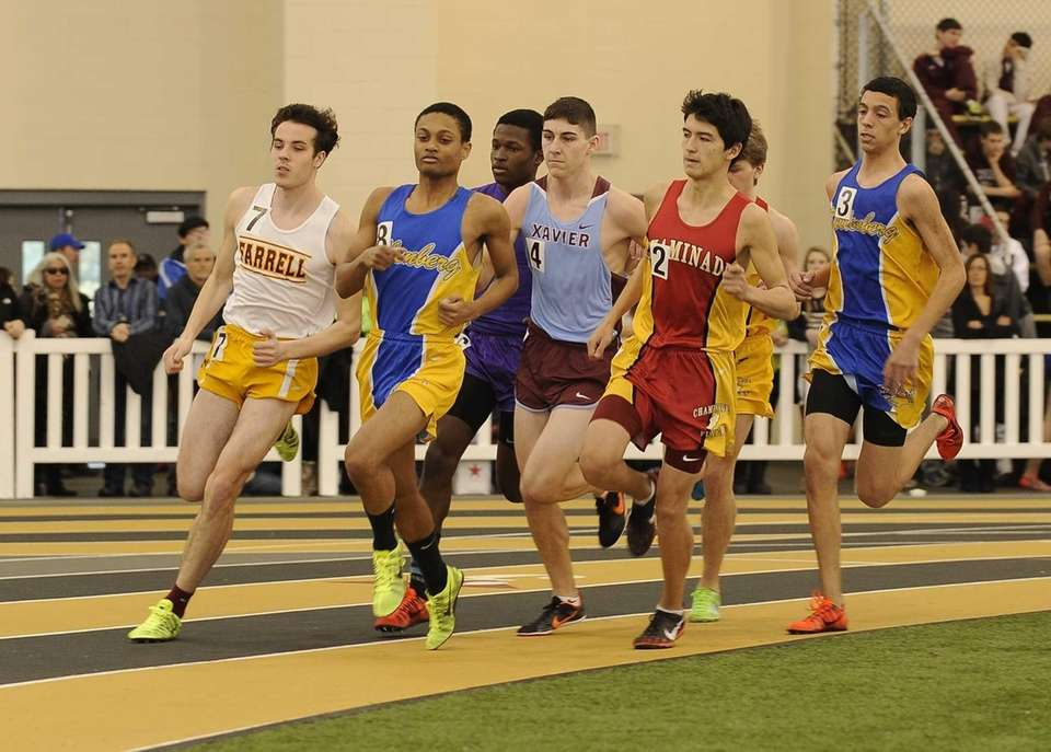 Runners compete in the boys 1,000-meter run at