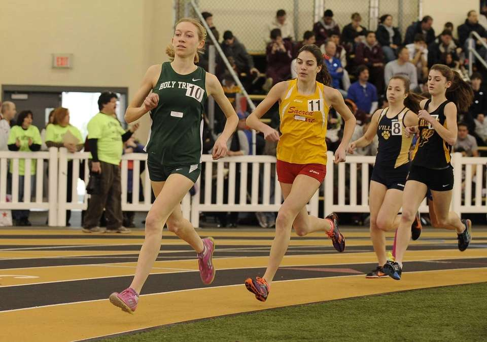 Holy Trinity's Caroline Brown, left, and Sacred Heart's