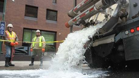 Work crews pump out flooded office buildings at