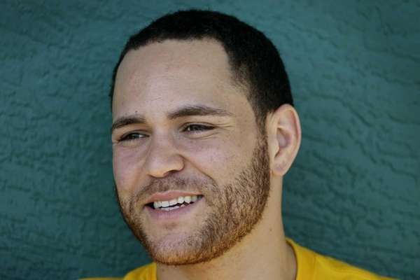 Pittsburgh Pirates catcher Russell Martin speaks to reporters