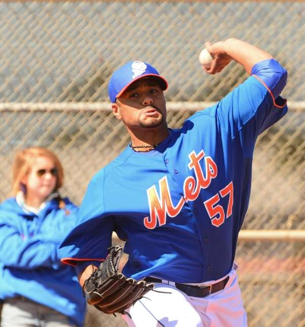 Johan Santana delivers a pitch during spring training