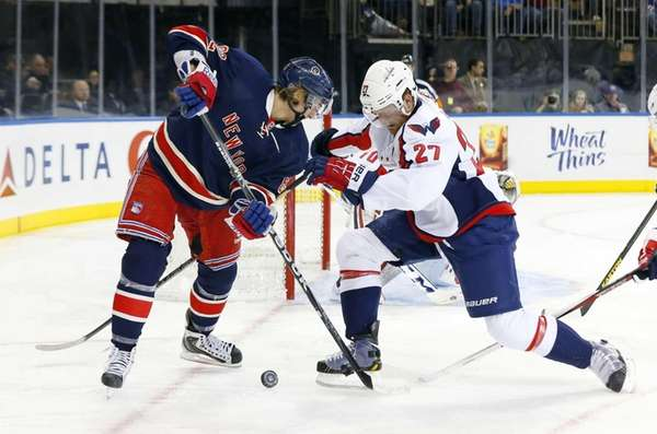 Carl Hagelin #62 tries to gain control of